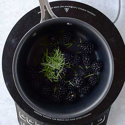Blackberry Bourbon Lemonade Step 1 - Add rosemary to saucepan.