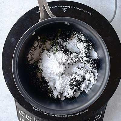 Blackberry Bourbon Lemonade Step 1 - Add powdered sugar to saucepan.