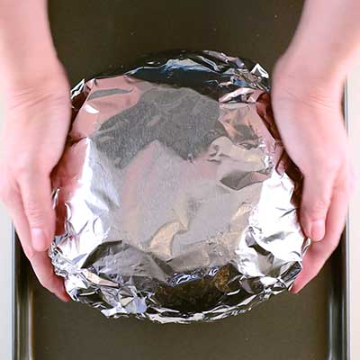 Mississippi Sin Dip Step 3 - Cover bread with aluminum foil and bake.