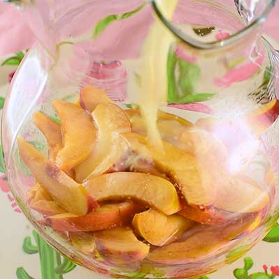 Peach Sangria Step 1 - Add lemonade concentrate.