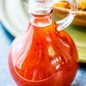 Catalina Dressing! Slightly creamy and with a sweet tomato taste, this Catalina salad dressing is perfect for garden salads, cold pasta salads, or garnish on a freshly grilled burger. Can be made in advance for easy weeknight dinners or quick potluck side dishes. | HomemadeHooplah.com