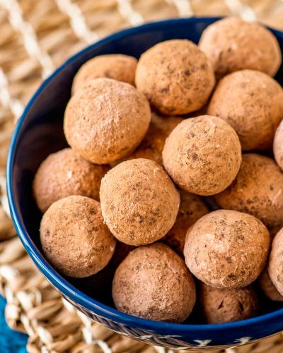 Kentucky Bourbon Balls! Dark chocolate truffles with the delicious sting of authentic Kentucky bourbon. A great candy for all year long and even better when snacking while watching the Kentucky Derby. | HomemadeHooplah.com