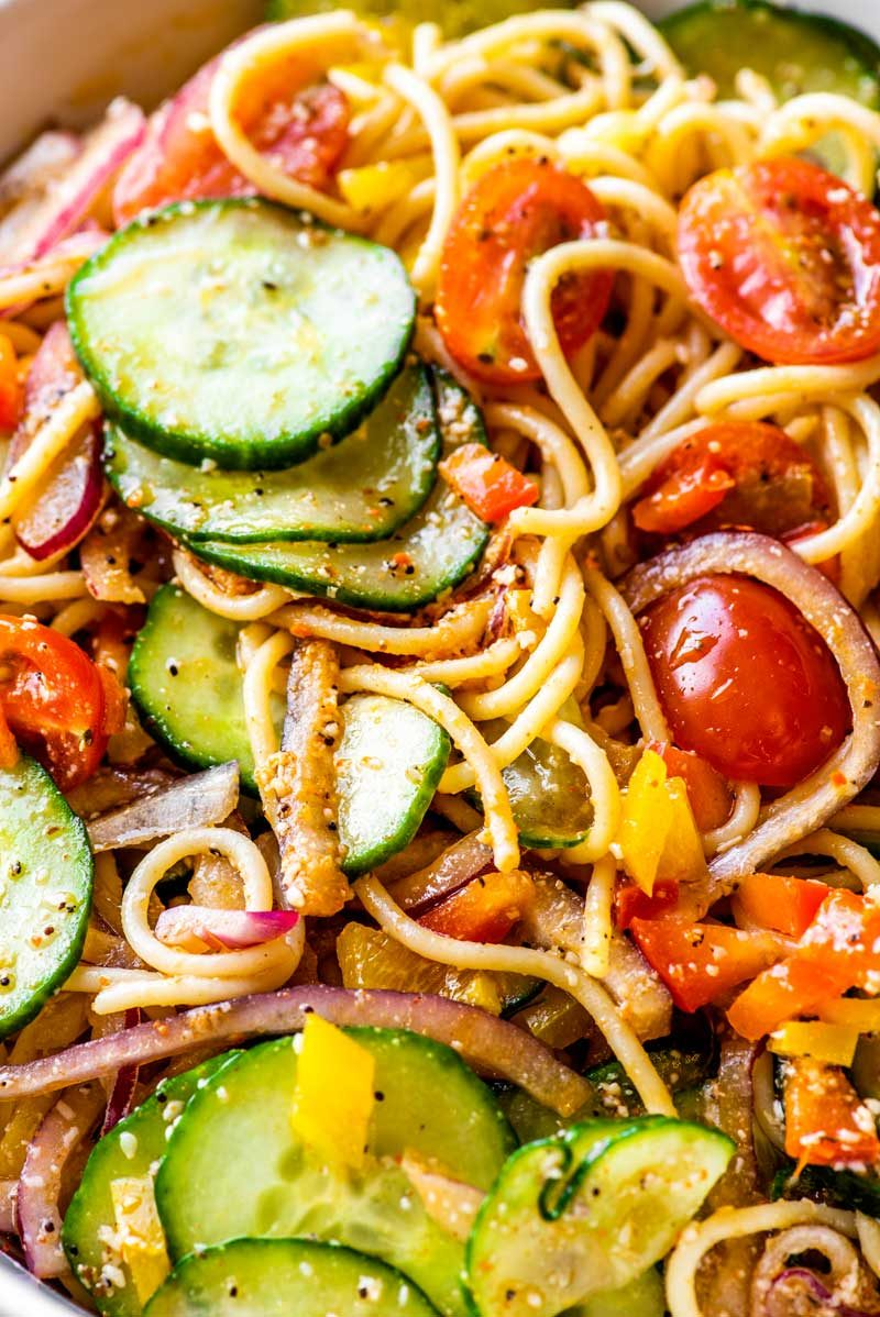 Pasta salad with spaghetti noodles.