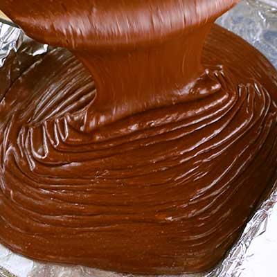 Triple Chocolate Fudge 6tep 5 - Pour fudge mixture into prepared baking dish.
