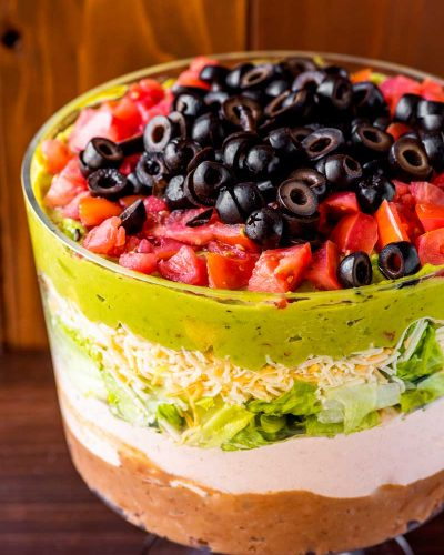 7 Layer Dip! When you're feeding a large crowd, nothing beats the presentation (and the utility!) of a 7 layer dip. The layers work their magic to create an appetizer that will keep your guests eating their way to their favorite flavors.   HomemadeHooplah.com