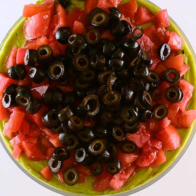 7 Layer Dip, Layer 7 - Sliced black olives.