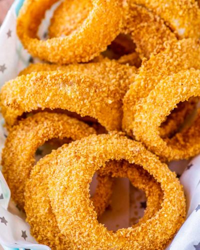 Baked Onion Rings! These baked onion rings are sliced thick, lightly seasoned, and cooked in the oven until tender on the inside and crisp on the outside. They're perfect for a healthier, low-hassle side dish or easy snacking. | HomemadeHooplah.com