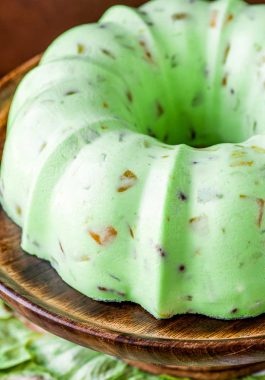 Creamy Lime Jello Salad! Flavored with lime jello and thickened with cream cheese and mayonnaise, this retro dessert has the sweet taste of lime sorbet with mixed fruit and pecans. | HomemadeHooplah.com