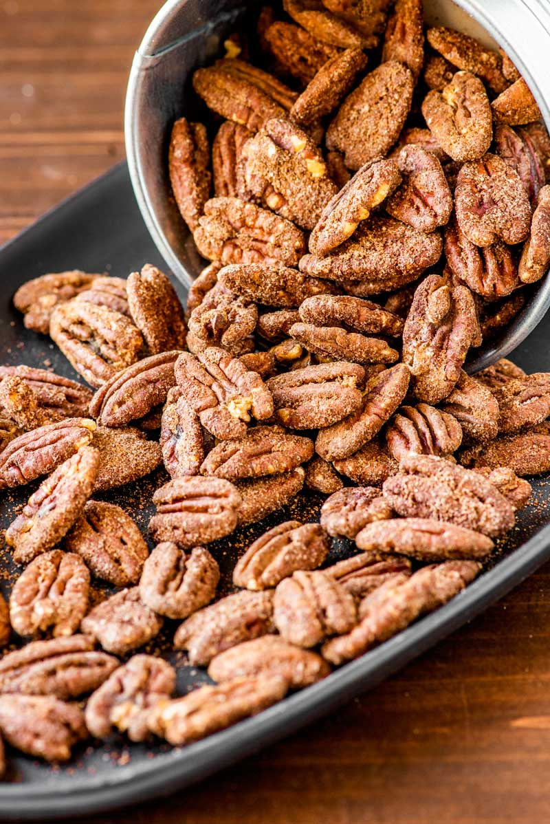 Sugar Coated Pecans! These sugar coated pecans are easy to make and can last for a few weeks, making them ideal gifts or a great snack to keep around the house. | HomemadeHooplah.com