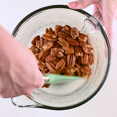 Sugar Coated Pecans Step 2 - Toss pecans in egg whites.