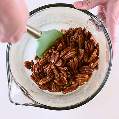 Sugar Coated Pecans Step 2 - Make sure pecans are coated in egg whites.