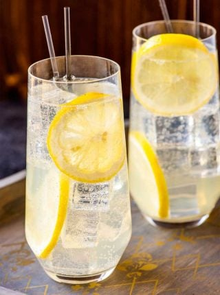"Tom Collins Cocktail! This classic Tom Collins is the go-to drink for gin lovers that want to add a dash of citrus flavor to an old favorite. Sometimes called a ""sparkling lemonade with gin,"" the ingredient list is so simple that most home bars can whip one up without a shopping trip. 