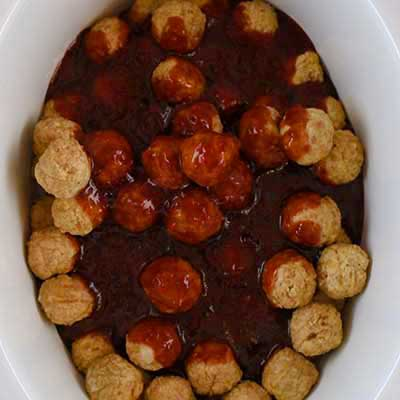 Crock Pot Grape Jelly Meatballs Step 2 - Cover meatballs with grape jelly sauce.