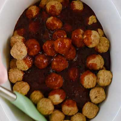 Crock Pot Grape Jelly Meatballs Step 2 - Toss meatballs in sauce.