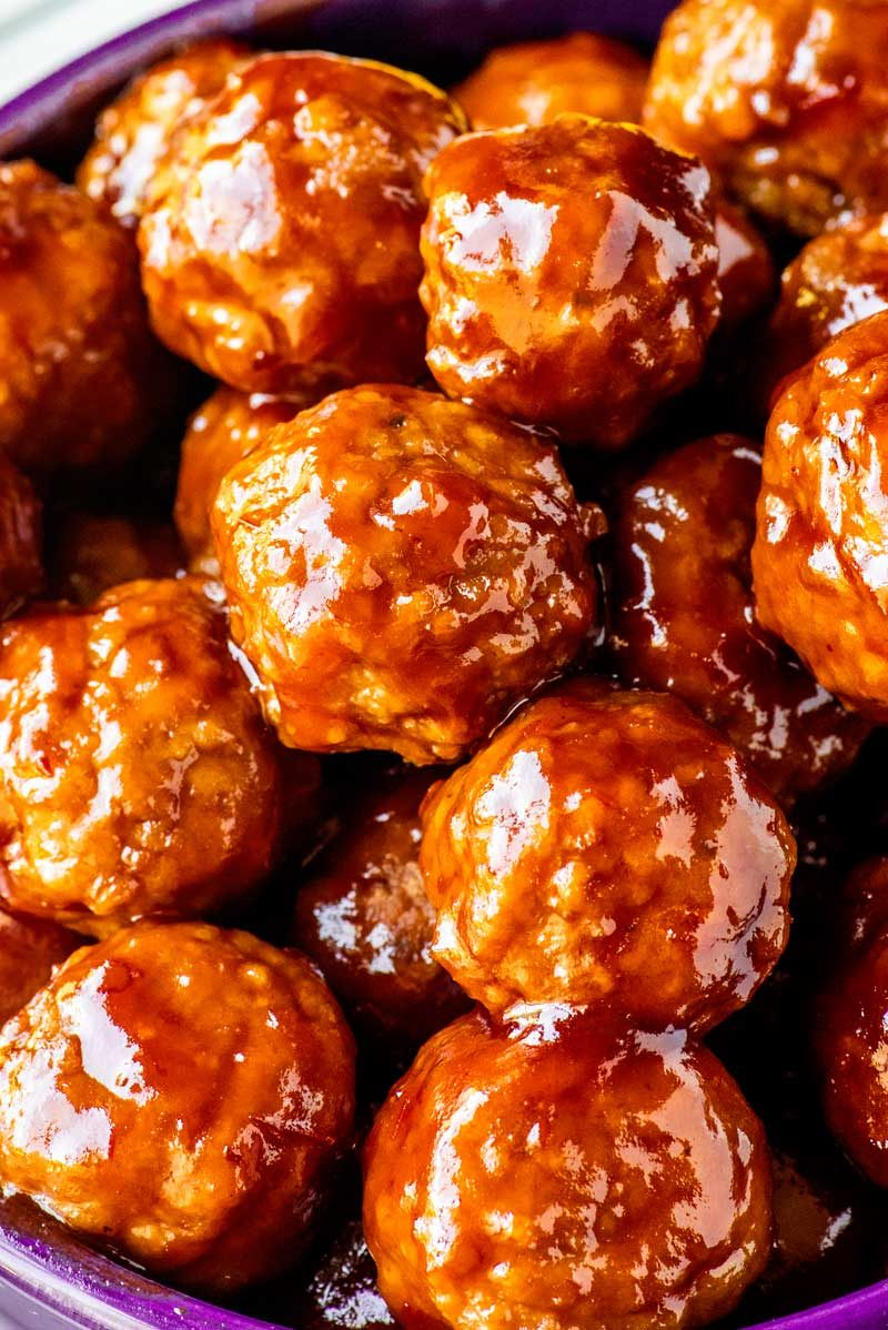 Frozen meatballs slow cooked with grape jelly and chili sauce.