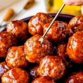 Crock Pot Grape Jelly Meatballs! Tender meatballs slow cooked in a sweet sauce made with grape jelly and chili sauce. Makes for a fun changeup of traditional cocktail meatballs for parties!   HomemadeHooplah.com