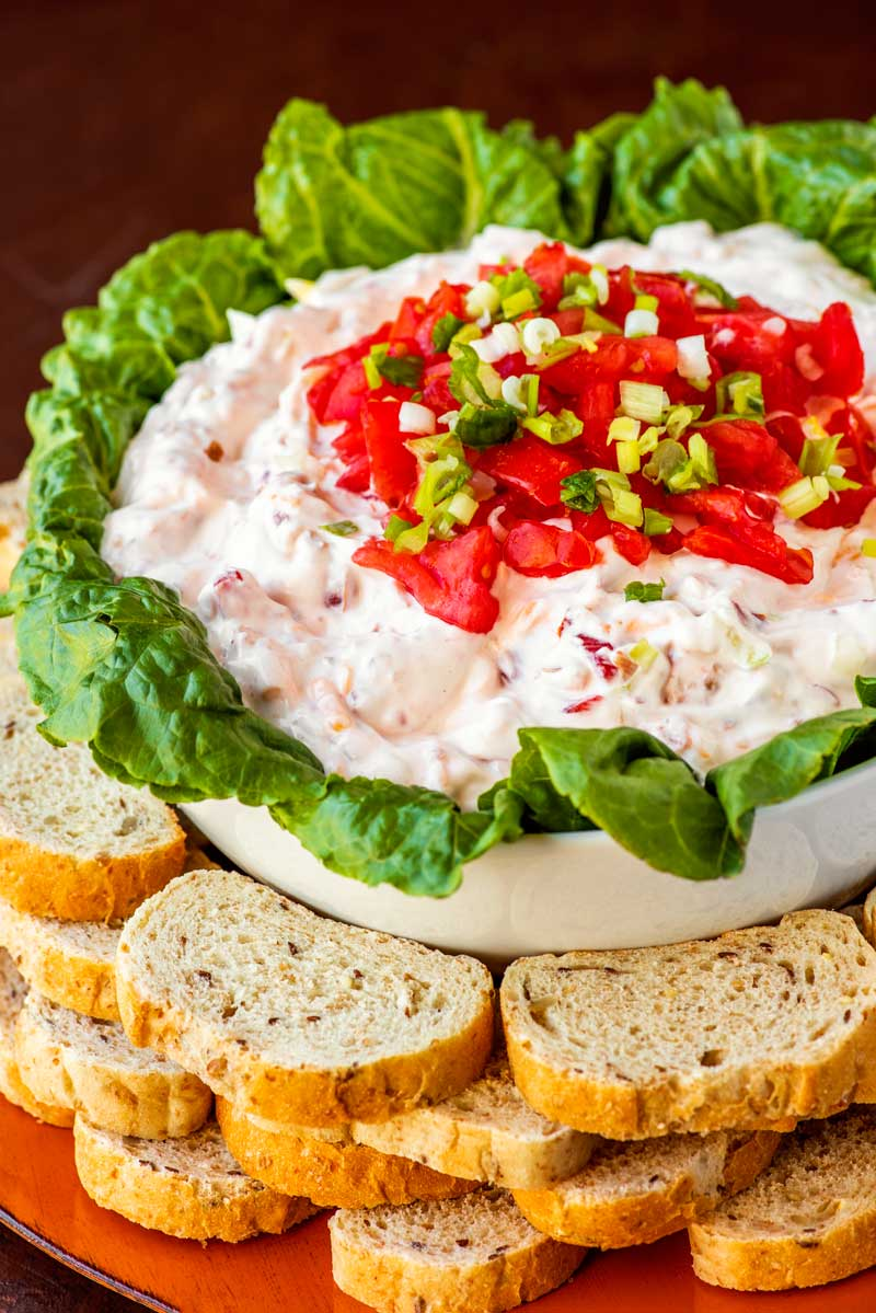 BLT Dip! The classic sandwich gets the appetizer treatment with this creamy chilled BLT dip. Line the bowl with lettuce leaves for a classy look and serve with toasted bread for an authentic BLT taste.   HomemadeHooplah.com