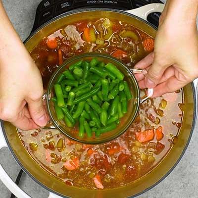 Hamburger Soup Step 3 - Add green beans.