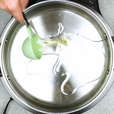 Homemade Kettle Corn Step 1 - Add vegetable oil.