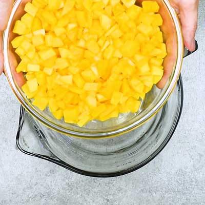 Mango Salsa Step 1 - Add mango.