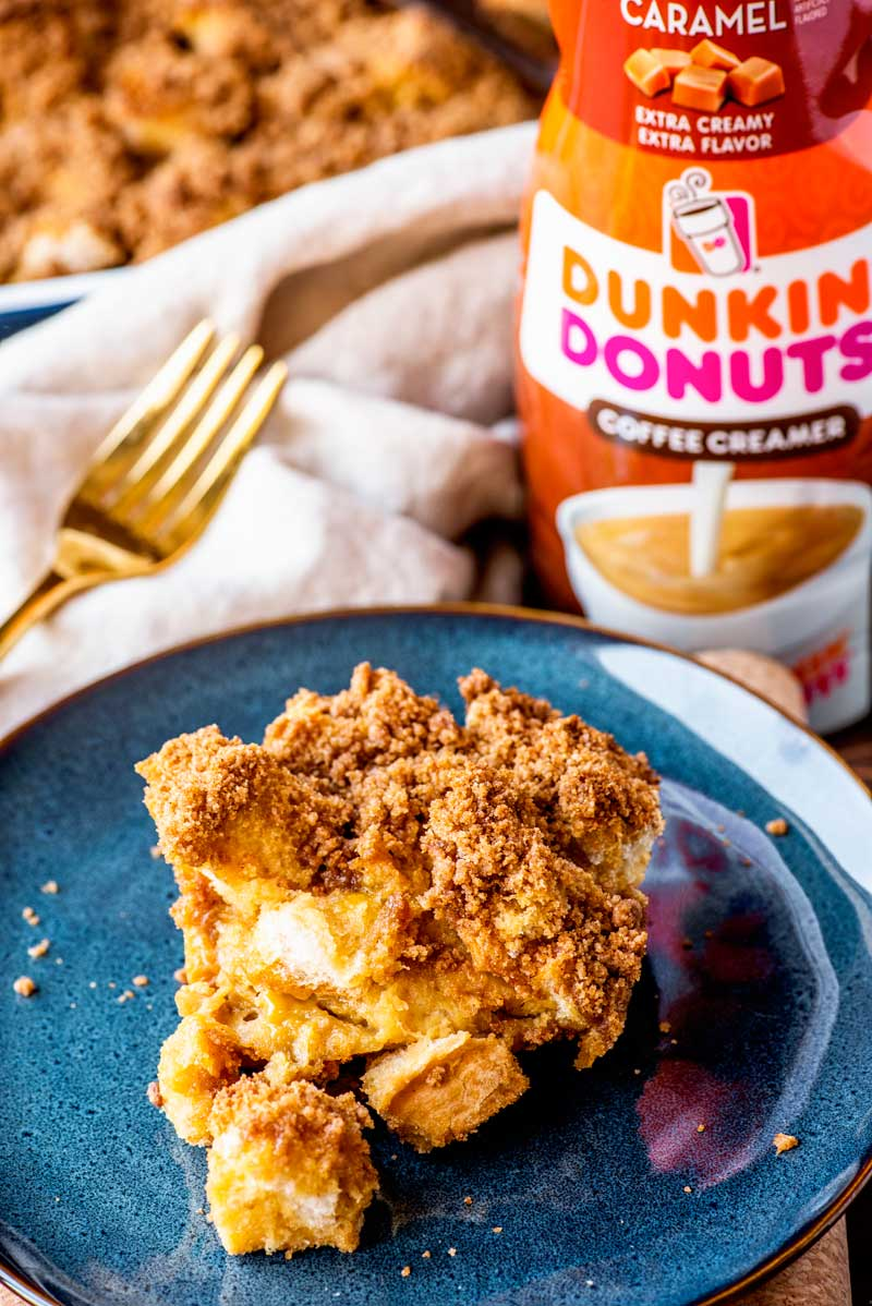 Caramel French Toast Casserole! With cubed french bread and the delicious taste of Dunkin' Donuts Extra Extra Caramel creamer, this no-hassle breakfast is perfect comfort food for relaxed weekend mornings. | #ad #MakeItExtra #AmericaRunsOnDunkin @DunkinDonuts