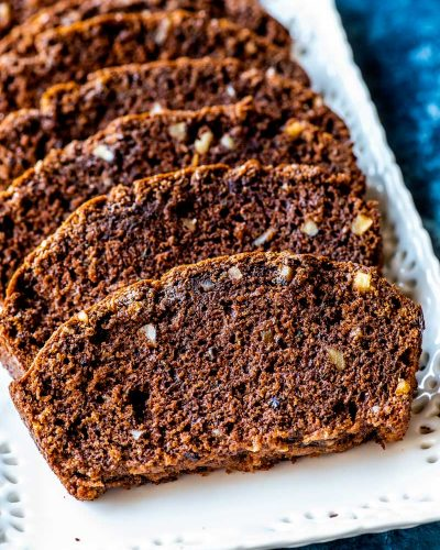 Chocolate Zucchini Bread! This classic recipe for ultra moist chocolate zucchini bread has a dark chocolate flavor and is laced with walnuts. Perfect for gifting, a quick breakfast, or an easy dessert! | HomemadeHooplah.com