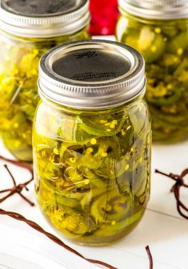 Candied Jalapenos! Whether you call them candied jalapenos or Candied Jalapenos, these little slices of sweet heat make for a great gift or a fun new topping for your favorite crackers, dips, or salads. | HomemadeHooplah.com