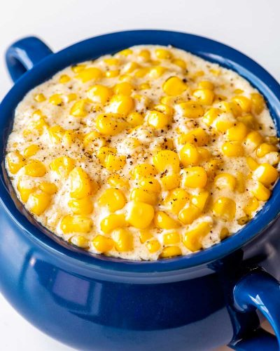 Crock Pot Creamed Corn! If you want to make creamed corn but you've run out kitchen space, this crock pot version is the perfect solution! The sweet, creamy taste is nearly identical to the baked version but this no-hassle version takes a fraction of the effort. | HomemadeHooplah.com