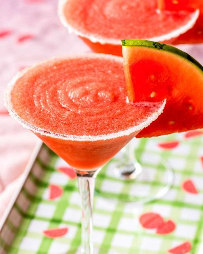 Frozen Watermelon Margarita! A frozen watermelon margarita is a perfect way to enjoy this summer-loving fruit! Easy to make and deliciously sweet, this drink can be made in advance and does not include ice so it will never water down! | HomemadeHooplah.com