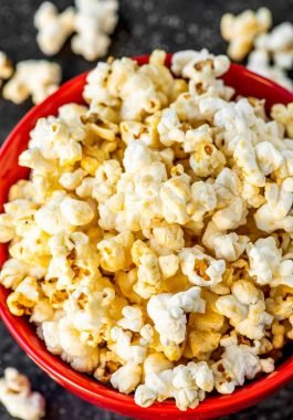 Homemade Kettle Corn! Perfect for a movie night or gifting by the bag, this homemade kettle corn will cure all your sweet and salty food cravings. Plus, you can make this festival favorite in less than 10 minutes! | HomemadeHooplah.com