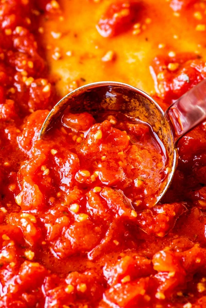 Homemade Marinara Sauce! This quick and easy homemade marinara sauce recipe will make sure you always have some delicious and flavorful sauce on hand. Plus, it can be made with canned or fresh tomatoes and freezes well. | HomemadeHooplah.com