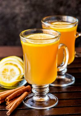 Hot Toddy! If you're looking for a natural (and effective!) way to battle the symptoms of a cold then a hot toddy is the perfect cure. Each ingredient in this simple drink help soothes congestion, cough, and aches. | HomemadeHooplah.com