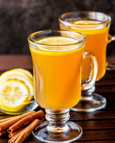 Hot Toddy! If you're looking for a natural (and effective!) way to battle the symptoms of a cold then a hot toddy is the perfect cure. Each ingredient in this simple drink help soothe congestion, cough, and aches. | HomemadeHooplah.com