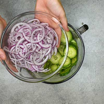 Cucumber Salad Step 2 - Add red onion.
