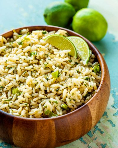 Cilantro Lime Rice! With tender white rice flavored with fresh cilantro and zesty lime, this cilantro lime rice is the perfect side dish for any Mexican-themed dinner. | HomemadeHooplah.com