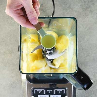 Homemade Dole Whip Step 1 - Add lemon juice.