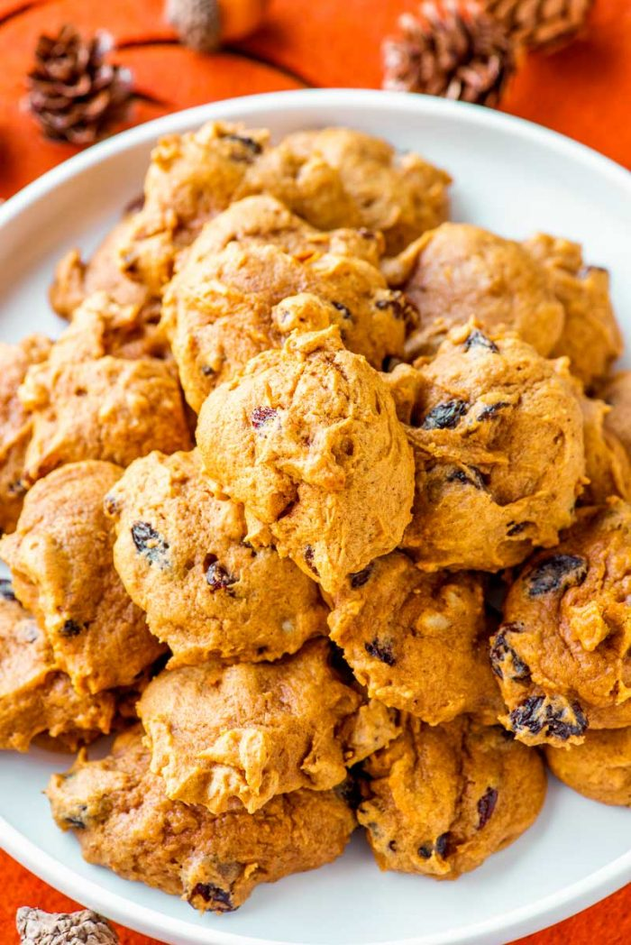 Pumpkin Drop Cookies! These ultra soft pumpkin drop cookies are laced with crunchy almonds and sweet raisins. They're the perfect treat to bake for festive fall comfort food.   HomemadeHooplah.com