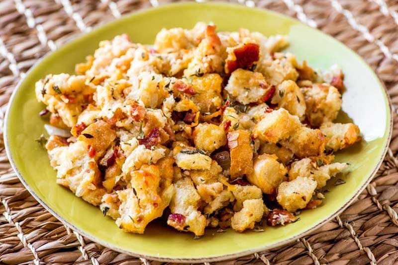 Bacon Beer Cheese Stuffing! This bacon beer cheese stuffing will kick your side dish game to the next level! Classic stuffing spiked with citrus beer, savory bacon, and cheddar cheese. | HomemadeHooplah.com