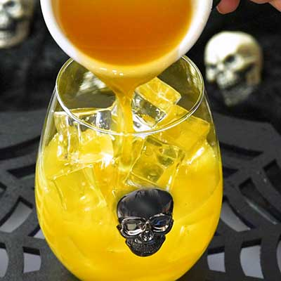 Skeletons in Your Closet Cocktail Step 2 - Add mango juice.