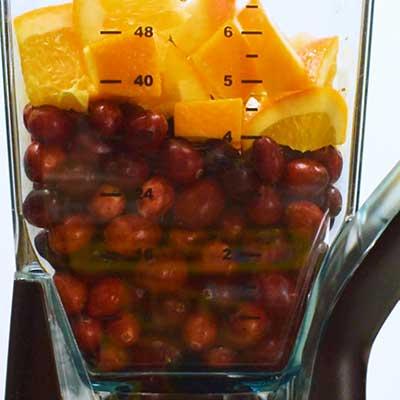 Fresh Cranberry Orange Relish Step 1 - Add orange to food processor.