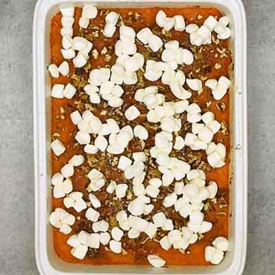 Sweet Potato Casserole Step 5 - Add marshmallows to top of casserole.