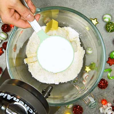 Grinch Cheese Ball Step 1 - Add powdered sugar.