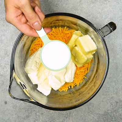 Easy Smoky Cheese Ball Step 1 - Add milk.