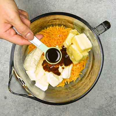 Easy Smoky Cheese Ball Step 1 - Add add Worcestershire sauce.
