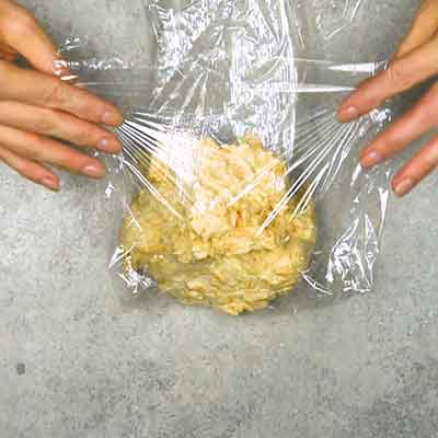 Easy Smoky Cheese Ball Step 2 - Wrap cheese ball in plastic.