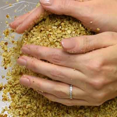 Easy Smoky Cheese Ball Step 4 - Cover cheese ball in pecans.