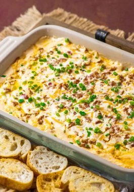 Boudin Dip! This Louisiana-inspired Boudin dip is baked hot and bubbly with spicy Boudin Cajun sausage, a mix of cheeses, and sour cream. Perfect for parties or game day! | HomemadeHooplah.com