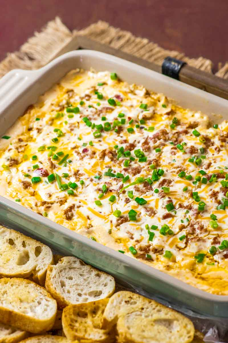 Boudin Dip! This Louisiana-inspired Boudin dip is baked hot and bubbly with spicy Boudin Canjun sausage, a mix of cheeses, and sour cream. Perfect for parties or game day! | HomemadeHooplah.com