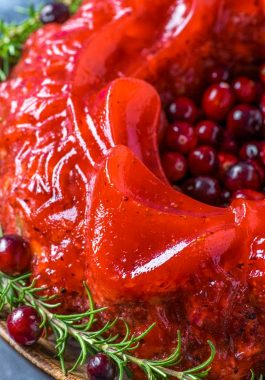 Cranberry Orange Jello Salad! This festively retro red jello salad comes together with sweet raspberry gelatin, lots of cranberries, oranges, and some walnuts and celery for a little crunch. | HomemadeHooplah.com