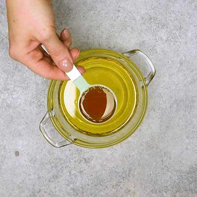 Cowboy Caviar Step 1 - Add honey.